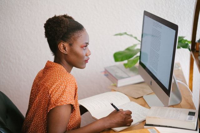 Woman studying to take her GMAT exam for grad school